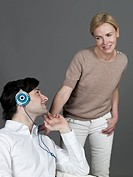 Man with earphones, woman looking at him