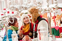 Austria, Salzburg, Man and women at christmas market, smiling (thumbnail)