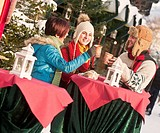 Austria, Salzburg, Man and women at christmas market, smiling