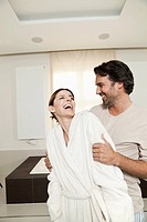 Germany, Berlin, Mature couple in bathroom, smiling (thumbnail)