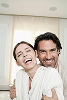 Germany, Berlin, Mature couple in bathroom, smiling