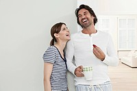 Germany, Berlin, Mature couple smiling, man holding strawberry