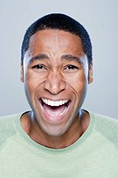 Portrait of laughing young man, studio shot