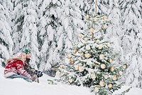 Austria, Salzburg County, Boy and girl watching christmas tree in snow
