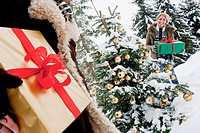 Austria, Salzburg County, Couple holding christmas gift in snow