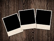 Vintage blank photos on wooden table, copy space