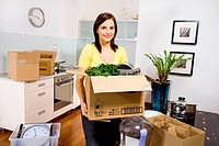 Woman packing equipment needed in the kitchen.