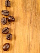 coffee beans on the wooden desk as food background