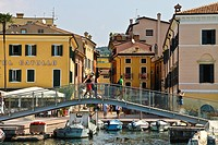 Bardolino harbor, new glass bridge, view town, boats, Lake Garda, Italy