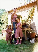 Mother with Two Daughters in Garden