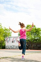 Girl skipping rope in the school playground