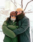 Couple in Winter Clothing on Snowy Day
