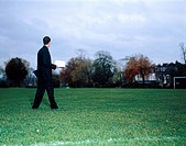 Businessman on Soccer Field