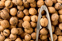 Detail of walnuts and nutcracker