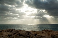 Sunbeams and clouds at the ocean
