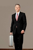 Businessman holding silver suitcase