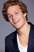 Smiling young man with curly hair