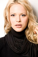Blond woman wearing turtleneck pullover and scarf