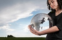 Girl holding transparent globe outdoors
