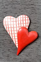 Two hearts on gray textile