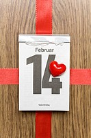 Red heart marking Valentine's Day on a calendar