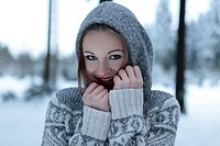 Attractive young woman in winter landscape