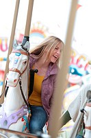 Happy woman on a carousel
