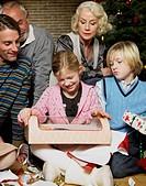 Girl With Christmas Present and Family