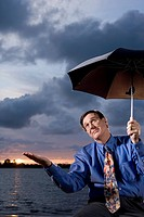 Businessman Waiting for Rain