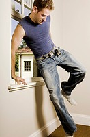 Man Jumping Through Window into Room