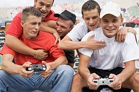 Young Men Playing Video Games Outside