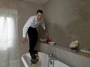 Man with Skateboard in Bathroom