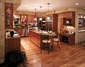 Contemporary Kitchen with Wood Cabinets and Floors
