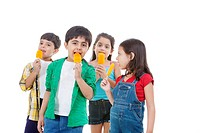Group of children eating flavored ice