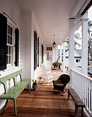 Long view of a traditional Southern wraparound porch