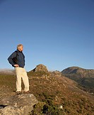 Man Standing in Mountain Landscape