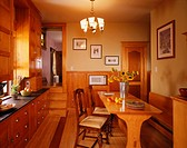 Warm brown dining room with counters and ample storage
