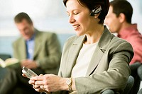 Businesswoman Using Wireless Headset Cell Phone