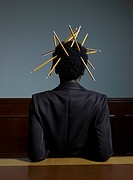 Businesswoman with Pencils Stuck to Her Hair