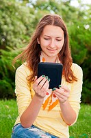 Teen girl reading electronic book