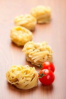 raw pasta tagliatelle and tomatoes
