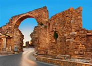 Road and ruins in Side, Turkey at sunset