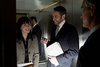 Businesspeople in an Elevator