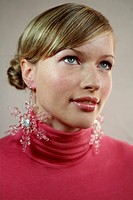 Young Woman Wearing Snowflake_Shaped Earrings