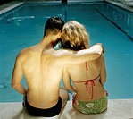 Couple at Edge of Swimming Pool
