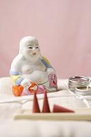 Buddha Figurine and Incense