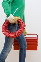 Woman Carrying Extension Cord and Toolbox