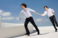 Businessmen Passing Baton