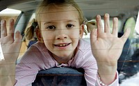 Little Girl Looking Through Car Window