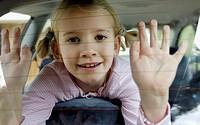 Little Girl Looking Through Car Window